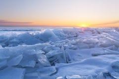 Dawn at the frozen lake shore Stock Image