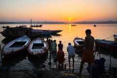 Dawn on Ganges river, with silhouettes of boats with pilgrims. VARANASI, INDIA - MAR 18, 2018: Dawn on Ganges river, with silhouettes of boats with pilgrims stock images