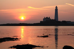 Dawn Glow. Sunrise at Saint Mary's Island and Lighthouse, nearby to Whitley Bay. On the coast of Northeast England Royalty Free Stock Images