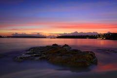 Dawn glow of the sunrise at Edwards Beach Stock Photo