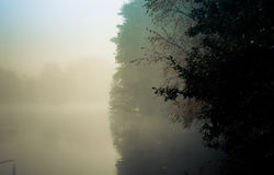 Dawn in Goldsworth Park Woking Surrey England at misty lake in d Royalty Free Stock Images