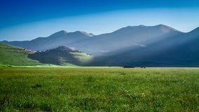 Dawn in green mountains at spring, Castelluccio, Italy stock video