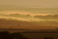 Dawn at harvest time in dorset. The blackmoor vale at harvest time as sun rises royalty free stock photos