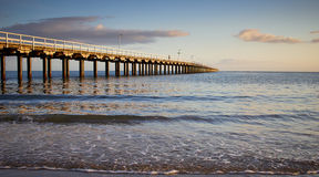 Dawn Urangan Jetty Hervey Bay Australia. Waiting on sunrise . One mile Jetty at Urangan Hervey Bay Australia. Small waves heading toward camera with jetty across Stock Image