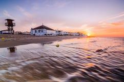 Dawn in het strand Royalty-vrije Stock Foto's