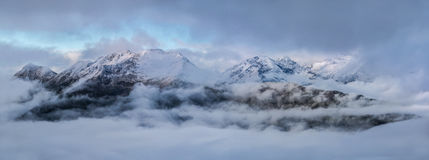 Dawn high in mountains on a foggy morning. Caucasus mountains. Royalty Free Stock Images