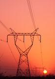 Dawn of high-voltage tower. Winter Sunrise under the high-voltage tower stock image