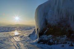 Dawn and icy island Lohmaty. Stock Photos