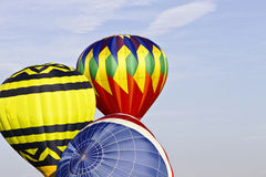 Dawn Inflation. Three hot air balloons inflate in preparation for a dawn mass ascension; copy space to right; Location is New Jersey Festival of Ballooning Royalty Free Stock Photos