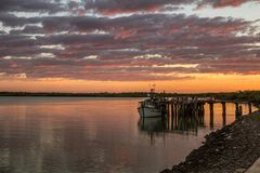 Dawn at Karumba. The rising sun reflects in the Norman River at Karumba, Queensland Stock Images