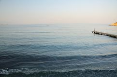 Calm Aegean Sea. Dawn in Kusadasi, Turkey. Holiday resort, early morning, calm Aegean Sea royalty free stock images