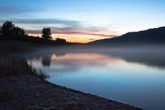 Dawn on the lake, harmony night  lake. Dawn on the lake. Harmony, calm water of the mountain lake night Stock Photo