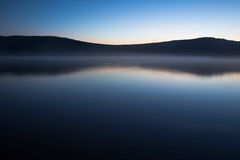 Dawn on the lake, harmony night  lake. Dawn on the lake. Harmony, calm water of the mountain lake night Stock Image