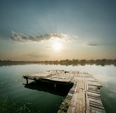Dawn on the lake with pier Royalty Free Stock Images