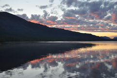 Dawn on a lake in the Putorana plateau. Royalty Free Stock Photos