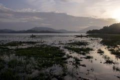 Dawn on the lake, Vietnamese fishermen cast nets stock image
