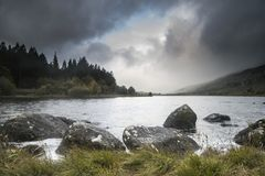 Dawn landscape image of Llynnau Mymbyr in Autumn in Snowdonia Na. Dawn landscape image of Llynnau Mymbyr in Snowdonia National Park Royalty Free Stock Image