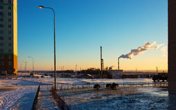 Dawn landscape with thermal power plant, winter time Stock Photo