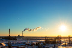 Dawn landscape with thermal power plant, winter time Royalty Free Stock Images