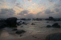 Dawn with Large Boulders Silhouetted in the Ocean in Aruba Stock Photos