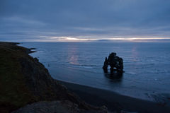 Dawn light at 5am, time for dragon Hvitserkur to drink water Royalty Free Stock Photo