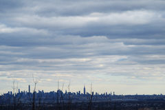 Dawn with low clouds.  NYC New York City, skyline.  From NJ New Jersey. Royalty Free Stock Photography