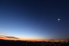 Dawn with low clouds.  Presunrise  Moon. NYC New York City, seen from NJ New Jersey. Royalty Free Stock Photography