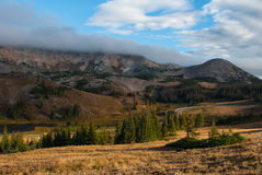 Dawn in the Medicine Bow Mountains. The clouds lift and slowly burn off as dawn comes to the Medicine Bow Mountains of Wyoming stock photo