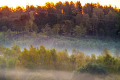 Dawn and mist landscape stock photography