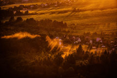 Dawn mist over the forest and village, Russia Royalty Free Stock Photos