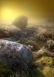 Dawn Mist on the Peaks. The sun burst through to illuminate the moor on a misty morning Stock Image