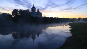 Dawn mist on the river near the church on the cliff high cliffs nature. Ural village of Sloboda. stock video footage