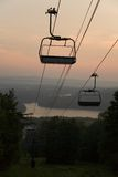Dawn on the Mountain. Silhouette of the ski lift from the middle of Mount Wachusett at dawn (on my father's 50th Stock Image