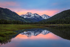 Dawn mountain reflection in the Uinta Mountains. Stock Image
