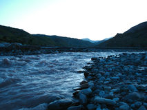 Dawn on a mountain river. In Muminabad Tajikistan Stock Photo