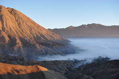 Dawn in The Mountain. A scenery in the top of Bromo Mountain when the sun is started to rise. Bromo Mountain is located in East Java, Indonesia. Easily access Royalty Free Stock Photo