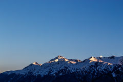 Dawn in the mountains. The edge of a mountain range in the first rays of the sun Stock Images