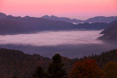 Dawn in the mountains and fog in the valley. Stock Photography