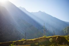 Dawn in the mountains of Georgia. The sun`s cold stock photography