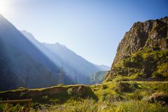 Dawn in the mountains of Georgia. The sun`s cold royalty free stock images