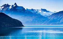 Dawn of Mountains and Lake General Carrera. Landscape of the sunrise and its reflections and colors of the mountains and mountain range of the Andes and the royalty free stock photography