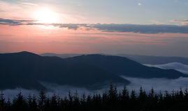 Dawn in the mountains Stock Image