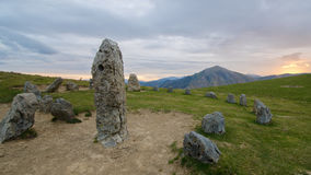 Dawn near a stone circle on a mountain of Navarre, Spain. Sunrise along a cromlech in a mountain of Navarra , Spain . First current level recorded made in Stock Photo