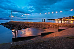 Dawn in Nyon. A stone pier at Nyon, Switzerland at early dawn Royalty Free Stock Photography