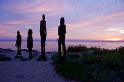 Dawn over the bay. Sculptures overlooking an australian sun rise Stock Images