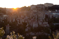 Dawn over the city of Sorano. Dawn over the old  famous tuff city of Sorano, province of Siena. Tuscany, Italy Stock Photo