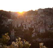 Dawn over the city of Sorano. Dawn over the old  famous tuff city of Sorano, province of Siena. Tuscany, Italy Royalty Free Stock Images