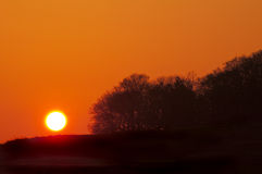 Dawn over english countryside. Summer sunrise over english woods in silhouette stock photo