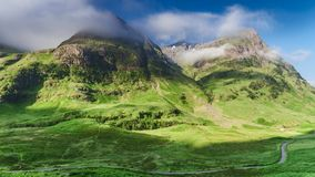 Dawn over the green mountains of Glencoe in Scotland stock video