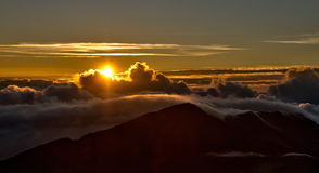 Dawn over Hawaiian volcano Stock Photos